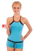 женщина фитнес, работающих с гантелями — Стоковое фото