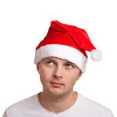 Genç adam noel baba şapkası — Stok fotoğraf