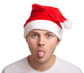 Young man in santa hat — Stock Photo