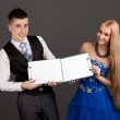 Young man and woman holding clip boards — Stock Photo