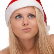 Young blond woman in santa hat — Stock Photo