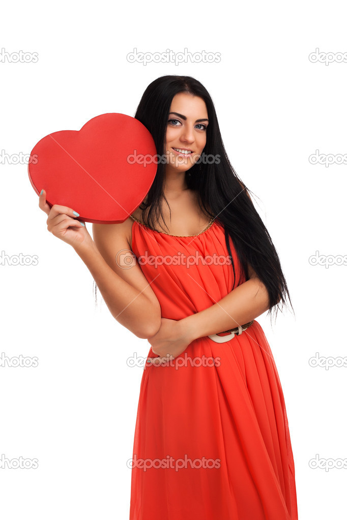 Woman holding Valentines Day heart sign. Isolated over white background  Stock Photo #18240517