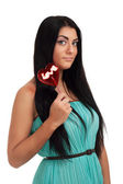 Girl holding heart candy — Stock Photo