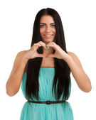 Young woman forming heart shape with hands — Stock Photo