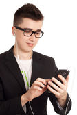 Young man with smartphone in hands — Stock Photo
