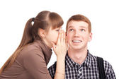 Young woman telling a secret to a man — Stock Photo