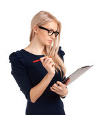 Smiling business woman writing on clipboard — Stock Photo