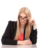Business woman looking at you over glasses — Stock Photo