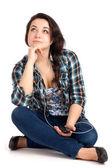 Teenage girl sitting and listen music — Stock Photo