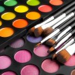 Makeup brushes and shadows - Stok fotoğraf