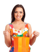 Beautiful woman holding shopping bag — Stock Photo