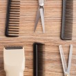 Barber accessories on wooden table — Stock Photo #28574607