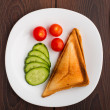 Grilled sandwich with vegetables on plate — Stock Photo