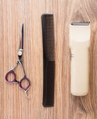 Barber accessories on wooden table — Stock Photo