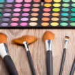 makeup brushes and eye shadows — Stock Photo