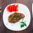 Grilled steak on white plate — Stock Photo