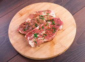 Raw steak with spices — Stock Photo