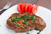 Grilled steak on white plate — Stockfoto