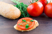Delicious tomato bruschetta with herbs — Stock Photo