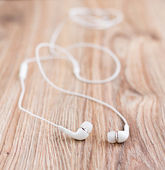 Audio earphones on a table — Stock Photo