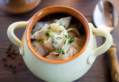 Fresh boiled meat dumplings served with dill — Stock Photo