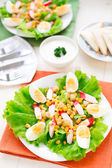 Salad with eggs, crab sticks and corn — Stock Photo