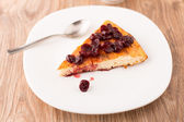 Cheesecake with berries sauce — Stock Photo