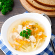 Stock Photo: Bowl of chicken soup with vegetables and noodles