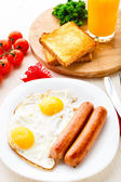 Fried eggs with sausages. — Stock Photo