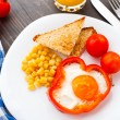 Fried egg in sweet paprika — Stock Photo #32500473