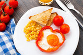 Fried egg in sweet paprika — Stock Photo