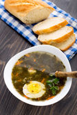 Delicious soup with sorrel — Stock Photo