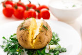 Baked potato with butter — Stock Photo
