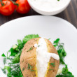 Baked potato with cream sauce — Stock Photo