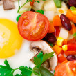 Fried eggs in a pan with vegetables — Stock Photo
