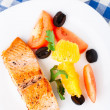 Salmon with oranges, tomatoes and olives — Stock Photo