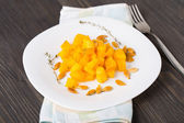Baked pumpkin with olive oil and thyme — Stock Photo