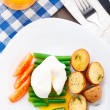 Poached egg with french beans and baked potato — Stock Photo