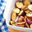 Baked potato with red onion — Stockfoto