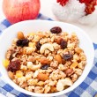 Stock Photo: Healthy muesli breakfast with huts and raisin