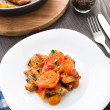 Fried pork with pan-roasted tomatoes — Stock Photo
