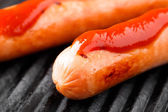 Sausages on a grill — Stock Photo
