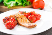 Salmon with roasted tomatoes — Stock Photo
