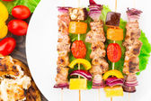 Barbecued pork and vegetable kebabs — Stock Photo