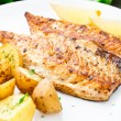 Fried mackerel with baked potato — Stock Photo