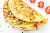 Omelet with diced vegetables — Stock Photo