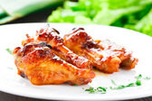 Chicken wings with honey sauce — Stock Photo