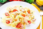 Delicious fettuccini with salmon and tomatoes — Stock Photo