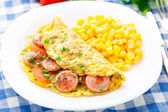 Omelet with sausage, tomato and herbs — Stock Photo