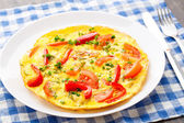 Omelet with paprika, tomato and herbs — Stock Photo